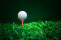 Golf ball ball driver and tee on green grass field Stock Photography