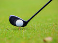 Golf ball behind driver at driving range Royalty Free Stock Images