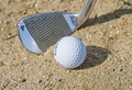 Golf ball in a bunker Royalty Free Stock Photo