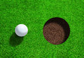 Golf Ball Close to Hole With Copy Space Royalty Free Stock Photo