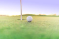Golf ball close to hole on green Royalty Free Stock Photo