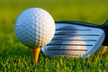Golf ball and driver on golf course Royalty Free Stock Photo