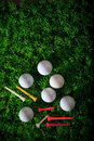 Golf ball driver and tee on green grass field Royalty Free Stock Image