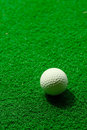 Golf ball on fake grass Stock Photo