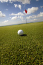 Golf ball and flag Royalty Free Stock Photo