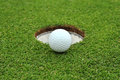 Golf ball go to lip hole Royalty Free Stock Photo