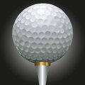 Golf ball on gold tee Stock Photography