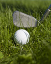 Golf ball and golf club Royalty Free Stock Photo