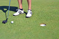 Golf ball golf shoes and stick the hole Royalty Free Stock Photography