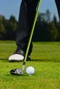 Golf ball golfer and club on green Stock Images