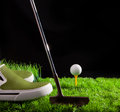 Golf ball on green grass field Stock Photo