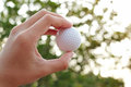 Golf ball on hand blur abstract Royalty Free Stock Photo