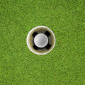 Golf ball in hole Royalty Free Stock Photography