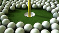 Golf ball hole assault an array of balls ominously challenging a on the green Royalty Free Stock Photography