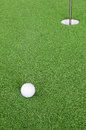 Golf ball and hole Royalty Free Stock Photo