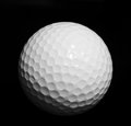 Golf ball isolated on black background Royalty Free Stock Image