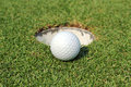 Golf ball on lip Royalty Free Stock Photo