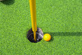 Golf ball on lip of cup. Royalty Free Stock Photo