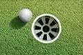 Golf ball near hole Royalty Free Stock Photo