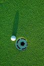 Golf ball on next to hole 3 Royalty Free Stock Photos
