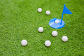 Golf ball on with  one in hole on grass Royalty Free Stock Photo