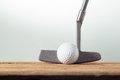 Golf ball and putter on old wood Royalty Free Stock Photos