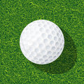 Golf ball realistic on the grass Stock Photos