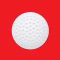 Golf ball on a red