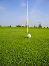 Golf ball rolling direction hole Stock Photo