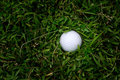 Golf ball in rough grass hard to play Stock Images
