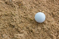 Golf ball in sand bunker with problem Royalty Free Stock Photos