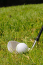 Golf ball on tee a with pitching wedge Royalty Free Stock Photography