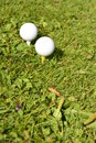 Golf ball vertical in grass Stock Photo