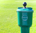 Golf ball washer over green baackground close up Stock Photography