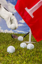 Golf balls green grass clouds background summer sports colorful concept with Stock Images