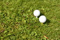 Golf balls horizontal in grass Stock Photos