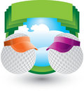 Golf balls with visors on green crest Stock Photo
