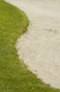 Golf bunker and grass sand on a course Stock Images