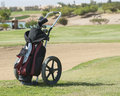 Golf caddy trolley on fairway Royalty Free Stock Photo
