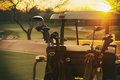 Golf cart 18th hole sun setting Royalty Free Stock Photo