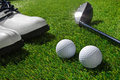 Golf club balls and shoes on grass a shot of Royalty Free Stock Images