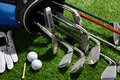 Golf clubs balls tee and glove a shot of Royalty Free Stock Photos