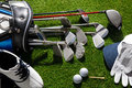 Golf clubs shoes balls hat and glove a shot of Stock Image