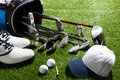 Golf clubs shoes balls tee and hat a shot of Stock Image