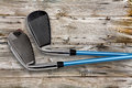 Golf clubs on wood Royalty Free Stock Photo