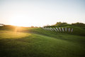 Golf course with collar at sunset Royalty Free Stock Photo