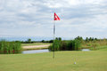 Golf course with flag and ball red Royalty Free Stock Photos