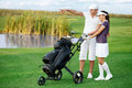 Golf course golfers on smiling couple men pointing front of them Royalty Free Stock Image