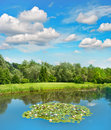 Golf course with lake and beautiful blue sky european landscape green field Royalty Free Stock Image