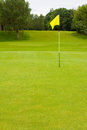 Golf course with large area for text including the flag and fairway a general golfing scene with no people Royalty Free Stock Photography